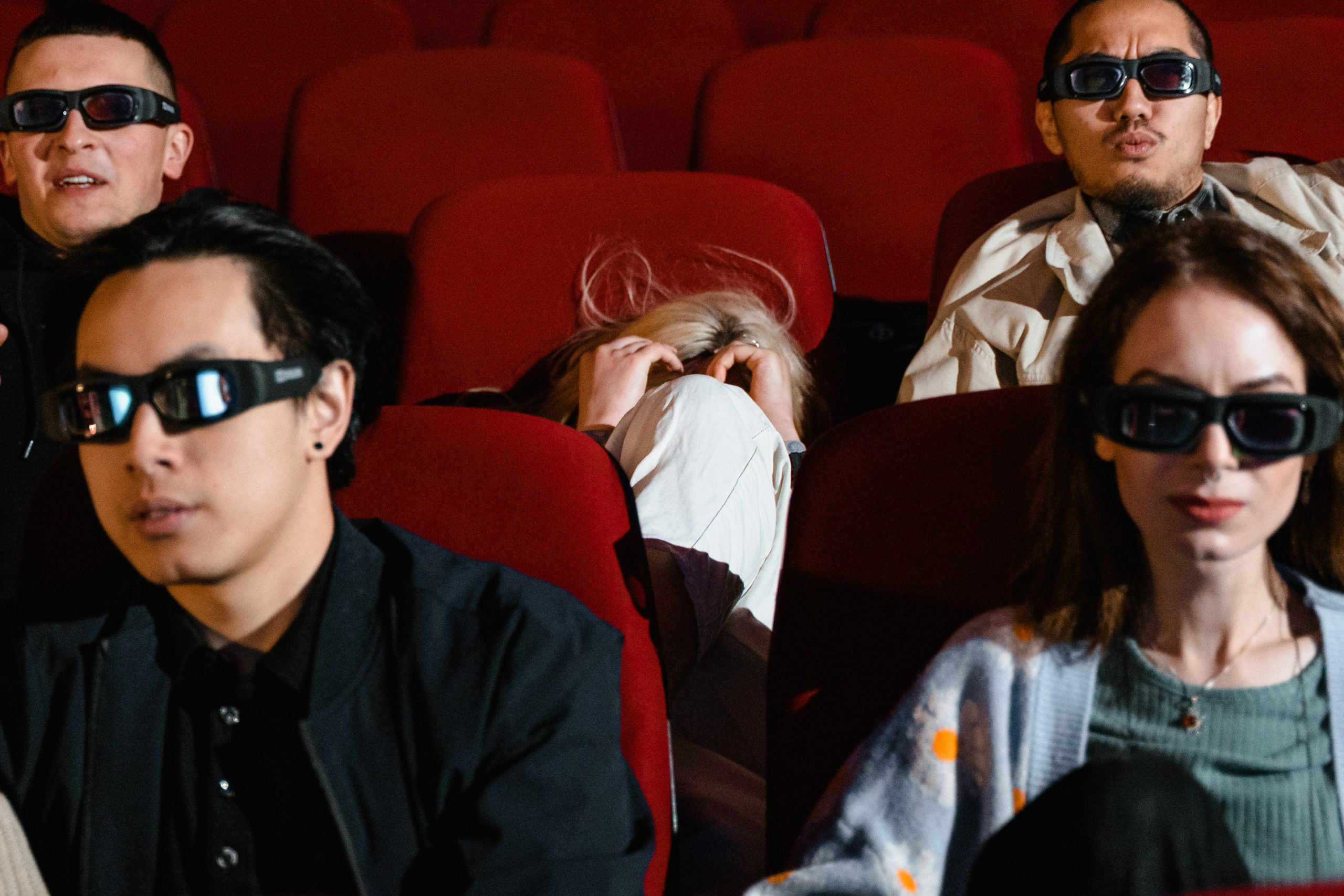 An image which shows people in 3d glasses, it relates to the article which speaks about 3D.
